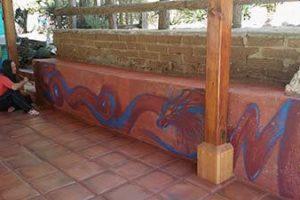 Michele making dragon mural