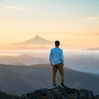 Man overlooking mountains
