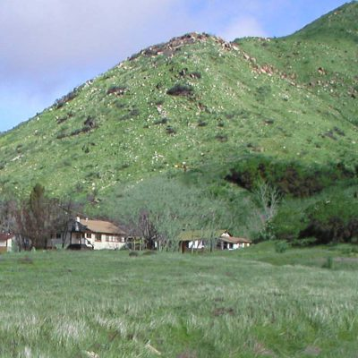 Green meadow and mountainside