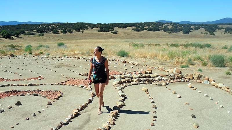 Michele walking the labyrinth at Manzanita Village